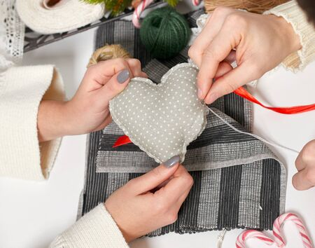 couple making decorations for Valentines day, recover damaged heart, top view - romantic and love concept