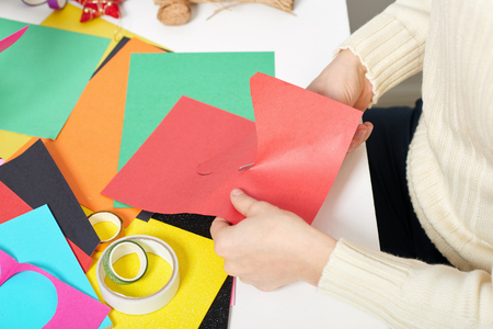 young couple making origami decorations for Valentine day, top view - romantic and love concept