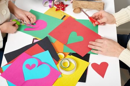 Young Couple Making Origami Decorations For Valentine Day Top