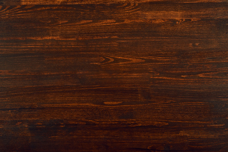 photo of natural wood for background or texture, dark red color