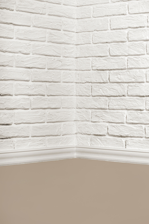 the corner of the room with white brick wall and floor, abstract background photo