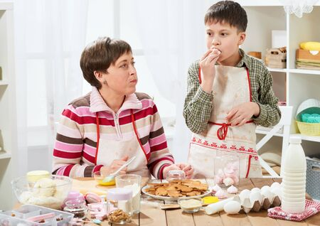 Mother and son cooking at home. Healthy food concept Standard-Bild