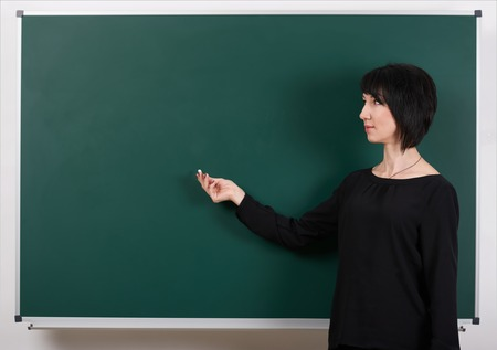 teacher show anything on chalk board, learning concept, green background, Studio shot Stock Photo