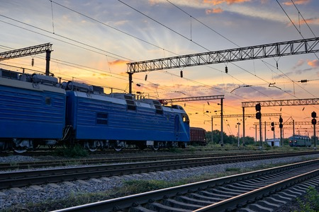 Railroad infrastructure during beautiful sunset and colorful sky, trains and wagons, transportation and industrial concept Stock Photo
