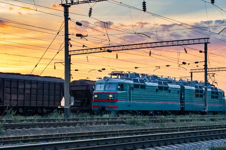Trains and wagons, railroad infrastructure, beautiful sunset and colorful sky, transportation and industrial concept Stock Photo