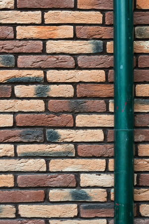 brick wall and drainpipe as background Stock Photo