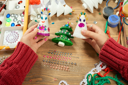 Childrens making decorations for new year holiday. Painting watercolors. Top view. Artwork workplace with creative accessories. Archivio Fotografico