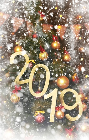2019 abstract text on the background of christmas tree and lights - bright holiday backdrop Imagens