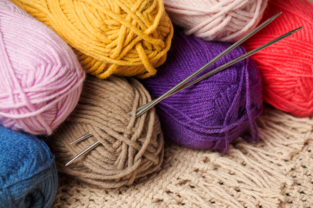 balls of woolen thread for knitting on wooden background Stockfoto