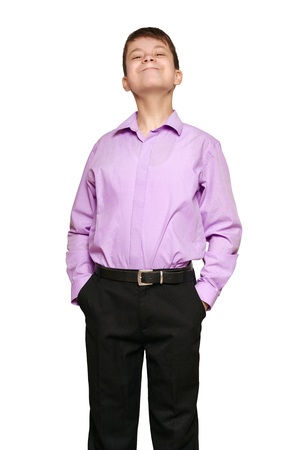 Boy posing on white background, black trousers and purple shirt Archivio Fotografico