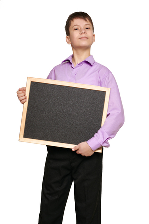 Boy posing on white background, black trousers and purple shirt Stockfoto