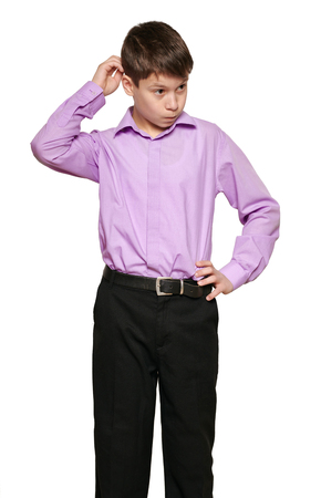 Boy posing on white background, black trousers and purple shirt Banque d'images