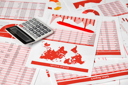 Businessman accountant using calculator for calculating finance on desk office. Business financial accounting concept. Red reports and graphs. Office employee examines schedules and reports. 版權商用圖片