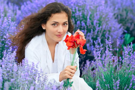 young woman with poppy is in the lavender flower field, beautiful summer landscape