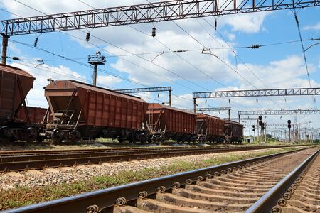 Industrial railway - wagons, rails and infrastructure, electric power supply, Cargo transportation and shipping concept.
