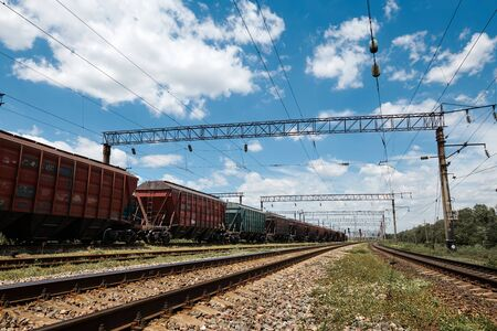 Industrial railway - wagons, rails and infrastructure, electric power supply, Cargo transportation and shipping concept. Banco de Imagens