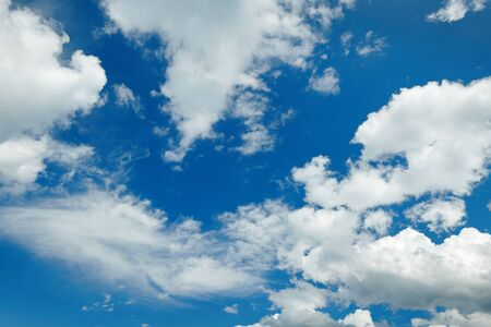 Bright blue sky with clouds for background or texture