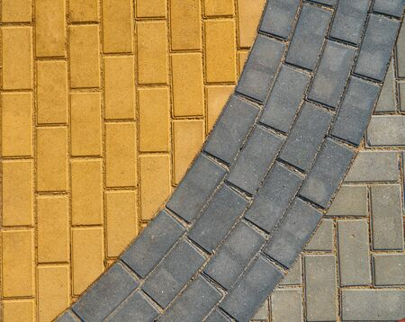 yellow and grey paving tiles for background or texture 写真素材