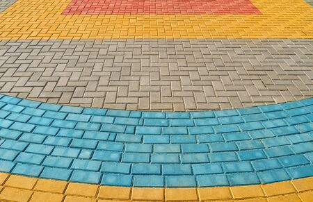 yellow, red and blue paving tiles for background or texture 写真素材