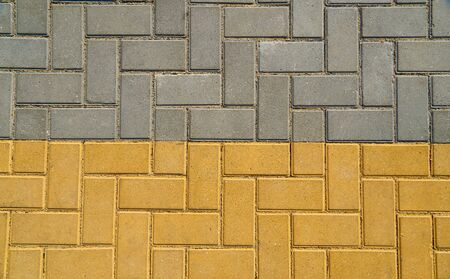 yellow and grey paving tile for background or texture