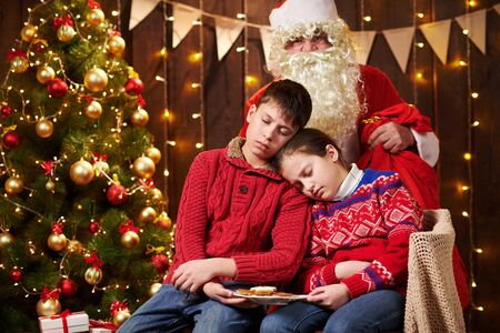 The children waited a long time for Santa, now they fell asleep and Santa quietly goes to the Christmas tree to give presents - Merry Christmas and Happy Holidays!