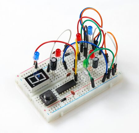 circuit mounting plate with mounted electronic component, unit, part, radio equipment and digital microchip - DIY kit for learning, training and development of electric circuits Stok Fotoğraf