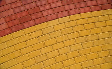 yellow and red brown paving tile for background or texture