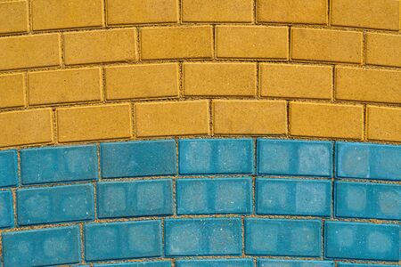 yellow and blue paving tiles for background or texture
