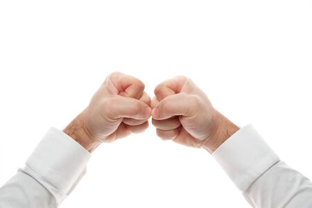 Man hands, knuckle gesture, isolated on white background. White shirt, business style.