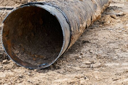 repair and replacement main pipeline of heating systems, district heating pipes network, water supply or Sewerage in city, removing old pipes and replacing them with new ones in a hole in the ground