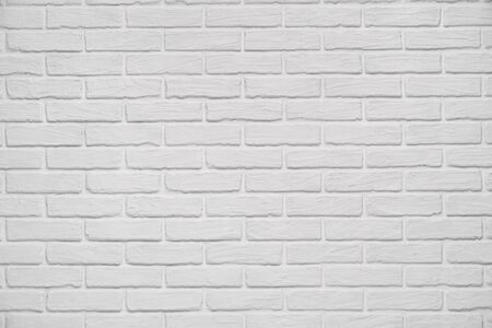 A white indoor brick wall abstract background or texture, new and clean, studio shoot