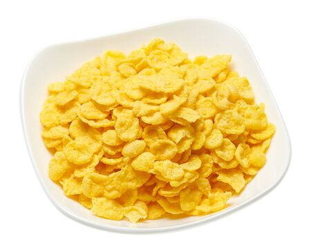 cereal flakes or corn flakes isolated on white background, macro photo
