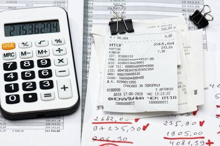 cash registers purchase receipt, calculator and financial reports, analysis and accounting, various office items for bookkeeping Stock Photo