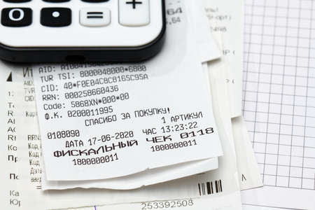 inscription in Russian - fiscal receipt, calculator and financial reports, analysis and accounting, various office items for bookkeeping Stock Photo