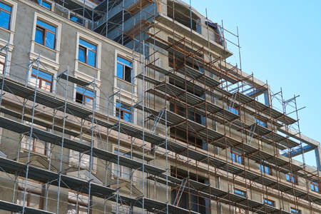 scaffolding and new building as background