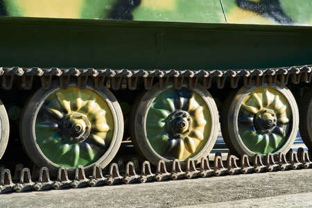 closeup of tank chassis, tracks and rollers