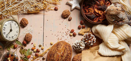 christmas decoration in rustic style and holiday background, still life on wooden backdrop, bread, nuts and other
