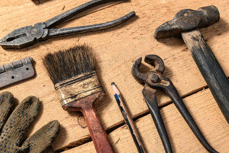 Old vintage household hand tools still life on a wooden background in a DIY and repair concept 版權商用圖片