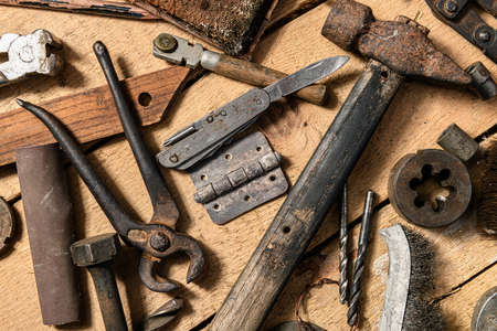 Old vintage household hand tools still life on a wooden background in a DIY and repair concept