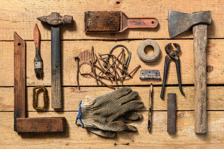 Old vintage household hand tools still life on a wooden background in a DIY and repair concept 写真素材