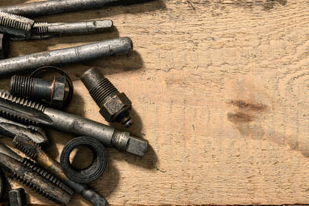 Old vintage drills and threading die tools on a wooden background