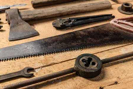 Variety of old vintage household hand tools still life on a wooden background in a DIY and repair concept