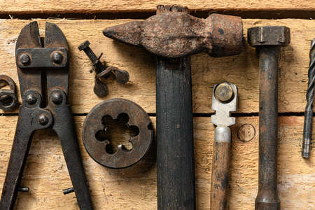 Old vintage household hand tools still life on a wooden background in a DIY and repair concept 免版税图像