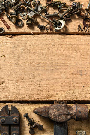 Old vintage household hand tools still life on a wooden background with copyspace and place for text