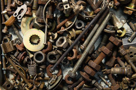 background from old vintage hand tools - set of different screws and nuts