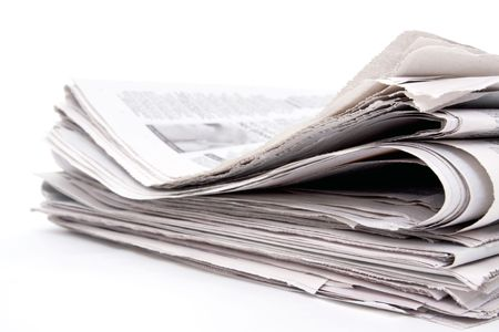Stack of newspaper on white background Stock Photo