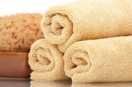 Spa towels and sponge on white background Stock Photo