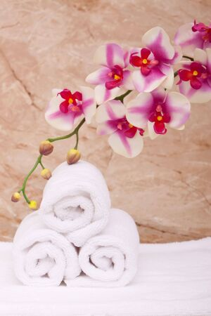 White spa towels with vibrant orchid