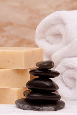 lastone: Stack of lastone therapy rocks with towels and soap