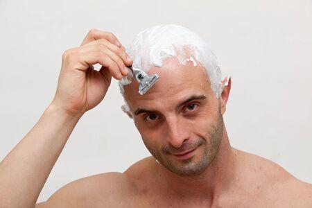 Young man shaving his head Stock Photo - 6459808
